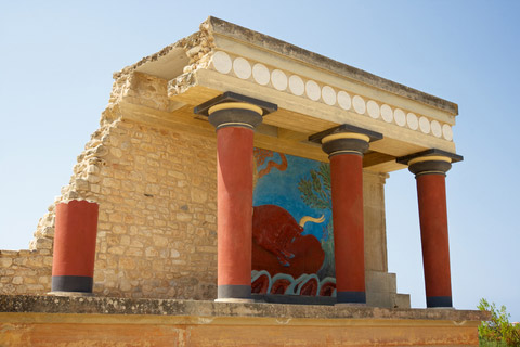 A restored section of the palace at Knossos.  coloured pillars,