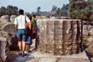 Impressive column drum among ruins and tourists